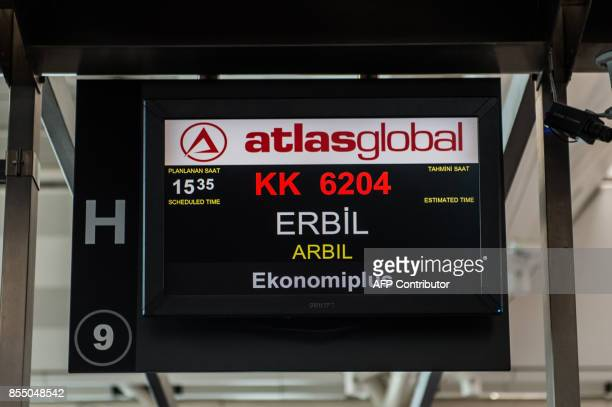 Information for a flight to Arbil is displayed on a screen in the checkin area at Ataturk International airport in Istanbul on September 28 2017 All...