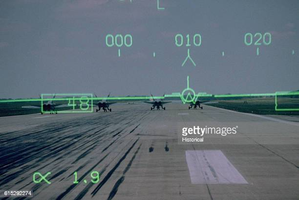 Information from the headup display is superimposed in the pilot's field of view in the cockpit of an F/A18C Hornet aircraft as it prepares to take...