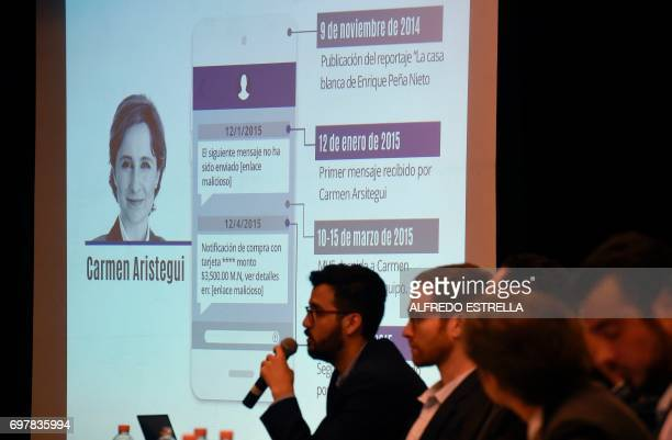 Information on Mexican journalist Carmen Aristegui is displayed on a screen during a journalists' a press conference in Mexico City on June 19 on an...