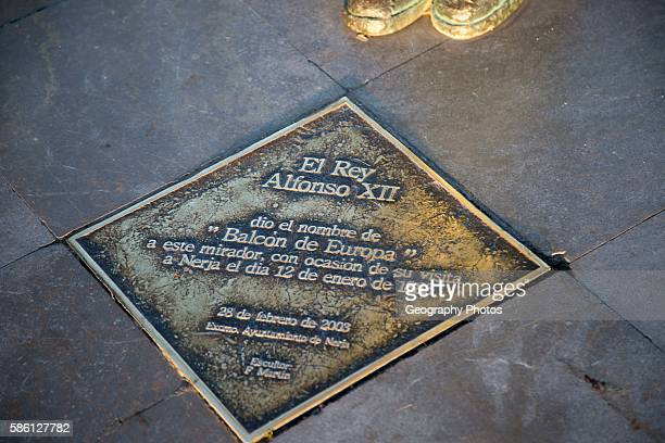 Information plaque about King Alfonso seventh statue by F Martin 2003 Nerja Malaga province Spain commemorating his visit in 1885