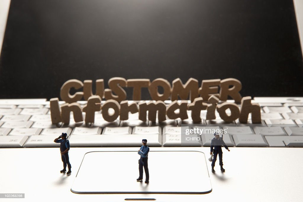 'CUSTOMER information' sign and 3 miniature guards : Stock Photo