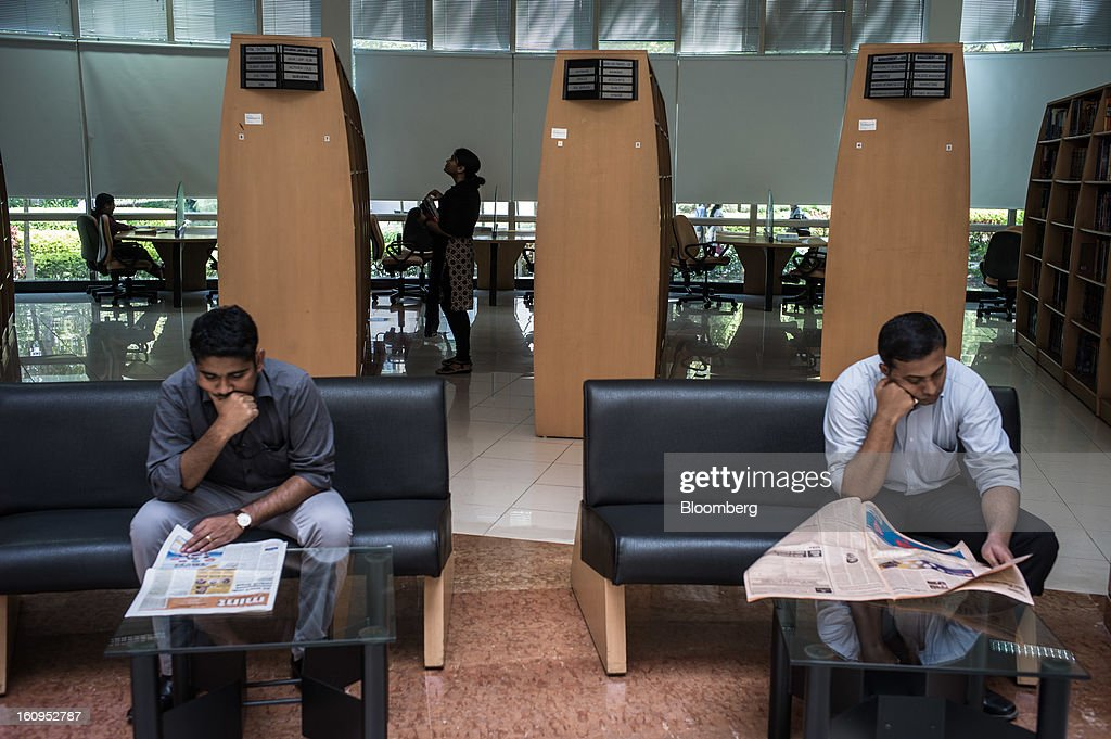 Infosys Ltd. employees read newspapers in the library at the company's campus in Electronics City in Bangalore, India, on Monday, Feb. 4, 2013. Infosys is India's No. 2 software exporter. Photographer: Sanjit Das/Bloomberg via Getty Images