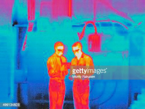 Infra red heat image of factory workers