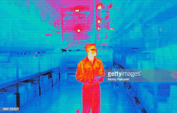 Infra red heat image of warehouse worker in factory
