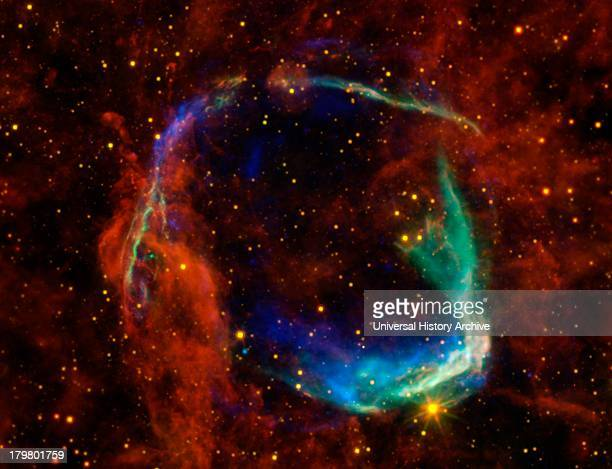 Infrared images from NASA's Spitzer Space Telescope WISE and Chandra are combined in this image of RCW 86 the dusty remains of the oldest documented...