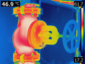 infrared thermal photo of valve on heating pipeline. heating is turned on, and image shows areas with highest and lowest temperature on valve. photo is taken with professional infrared thermal camera.