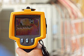 Infrared Thermal Imaging Camera Pointing to Electrical Transformer