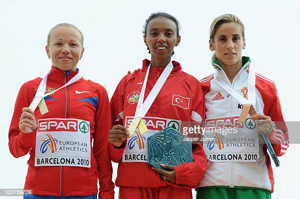 Inga Abitova of Russia receives the silver medal Elvan Abeylegesse of Turkey receives the gold medal and Jessica Augusto of Portugal receives the...