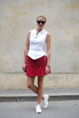 Inga Kozel poses wearing Azzedina Alaia Couture top and skirt Chanel Couture shoes and Chanel clutch after Dior show on July 7 2014 in Paris France