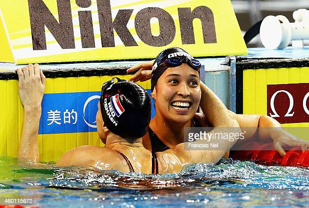 Inge Dekker congratulate Ranomi Kromowidjojo after winning the Women's 50m Freestyle Final during day four of the 12th FINA World Swimming...