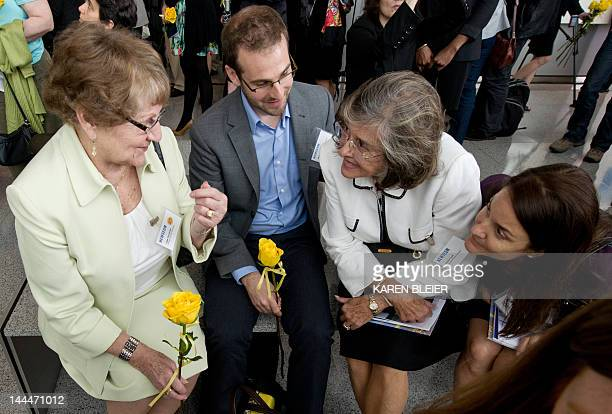 Inge Hondros mother of slain photojournalist Chris Hondros speaks with some of his close friends during a rededication ceremony at the Newseum in...