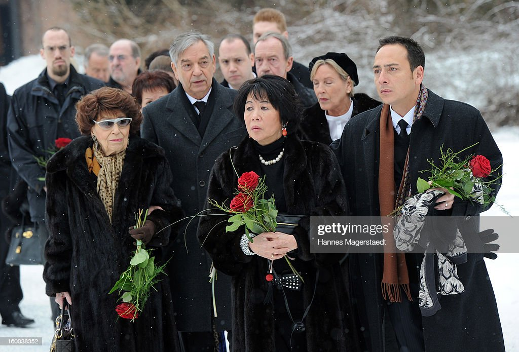 Ingeborg Kuchenreuther (L), mother of Steffen Kuchenreuther, Thomas Kuchenreuther Brother of Steffen Kuchenreuther, Soo Leng-Kuchenreuther and son Jeremy Wilson attend the memorial service for Steffen Kuchenreuther at the Waldfriedhof on January 25, 2013 in Munich, Germany.