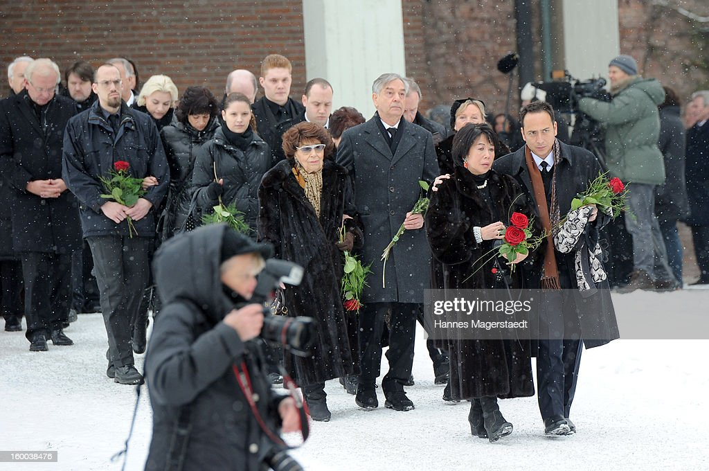 Ingeborg Kuchenreuther (L-mother of Steffen Kuchenreuther), Thomas Kuchenreuther (Brother of Steffen Kuchenreuther), Soo Leng-Kuchenreuther and son Jeremy Wilson attend the memorial service for Steffen Kuchenreuther at the Waldfriedhof on January 25, 2013 in Munich, Germany.