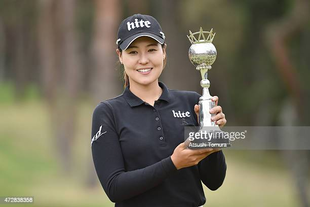 InGee Chun of South Korea poses with a trophy after winning the World Ladies Championship Salonpas Cup at the Ibaraki Golf Club on May 10 2015 in...