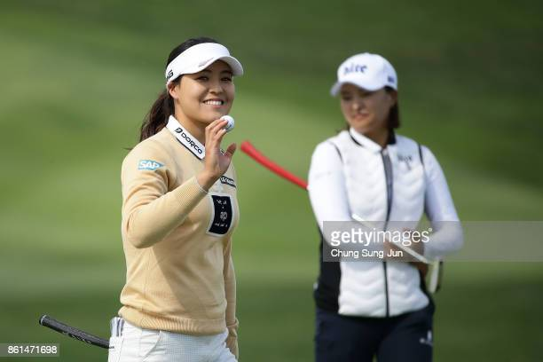 InGee Chun of South Korea reacts after a birdie putt as JinYoung Ko of South Korea looks on the 9th green hole during the final round of the LPGA KEB...