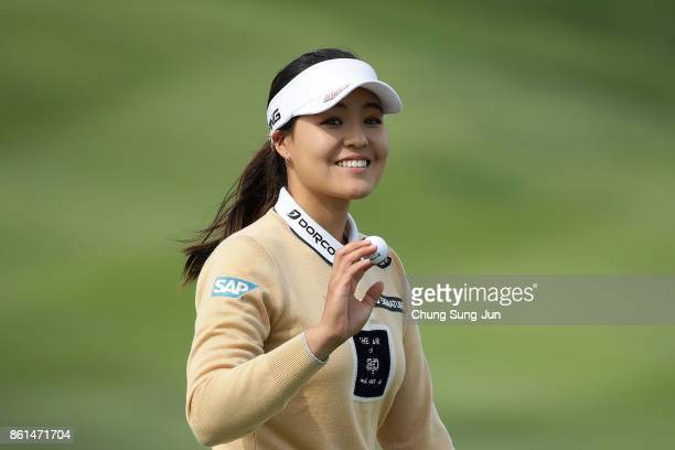 InGee Chun of South Korea reacts after a birdie putt on the 9th green hole during the final round of the LPGA KEB Hana Bank Championship at the Sky...