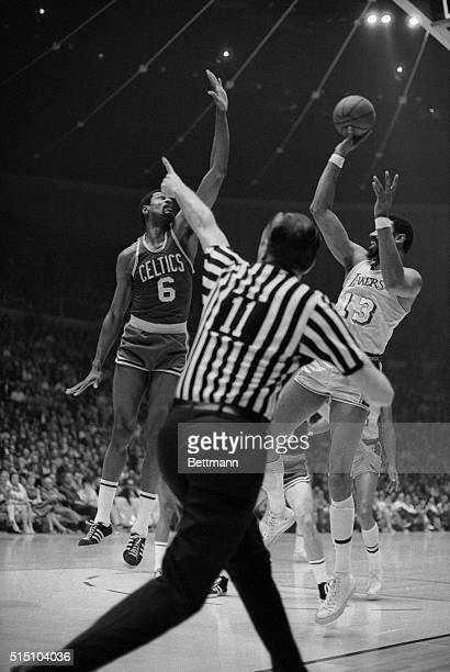 NBA Official Joe Gushue seems to be pointing the way for Los Angeles Lakers Wilt Chamberlain during the first quarter of fifth game of the NBA...