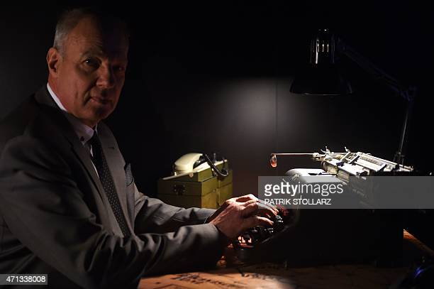 Ingo Mersmann director of the Spy Museum 'Top Secret' sits on the original typewriter of Traudl Junge the secretary of former German dictator Adolf...