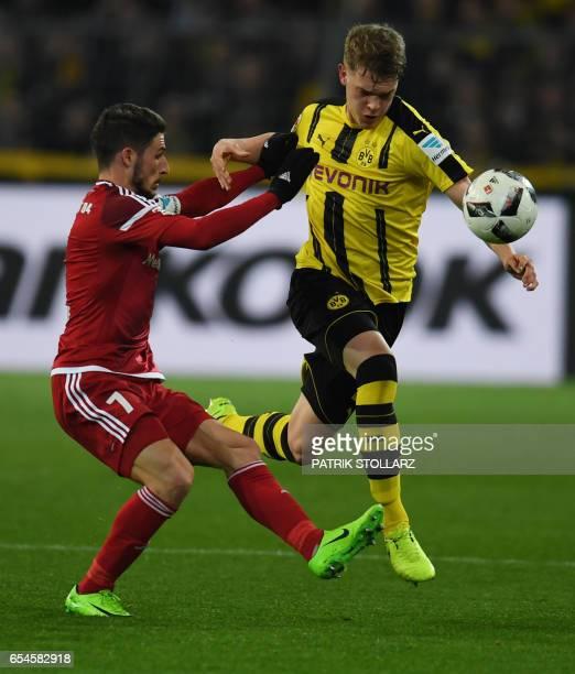 Ingolstadt´s Australian forward Mathew Leckie and Dortmund's defender Matthias Ginter vie for the ball during the German first division Bundesliga...