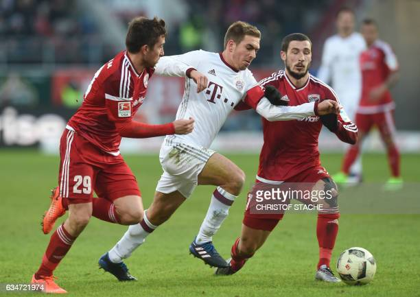 Ingolstadt's Austrian defender Markus Suttner Bayern Munich's defender Philipp Lahm and Ingolstadt's Australian striker Mathew Leckie vie for the...