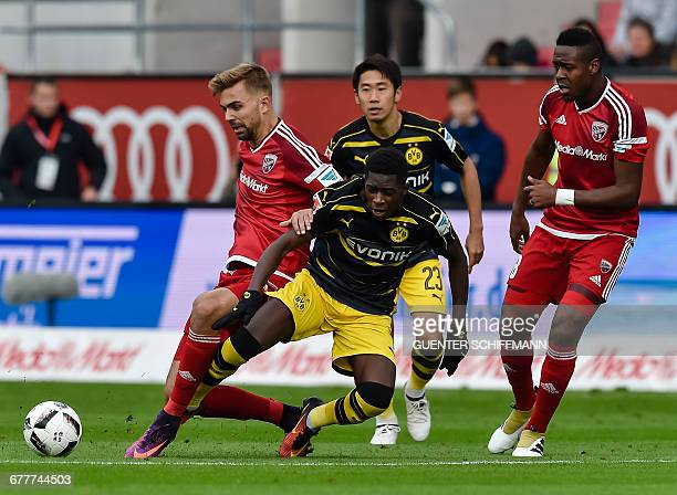 Ingolstadt's Austrian striker Lukas Hinterseer and Dortmund's French striker Ousmane Dembele vie for the ball during the German first division...
