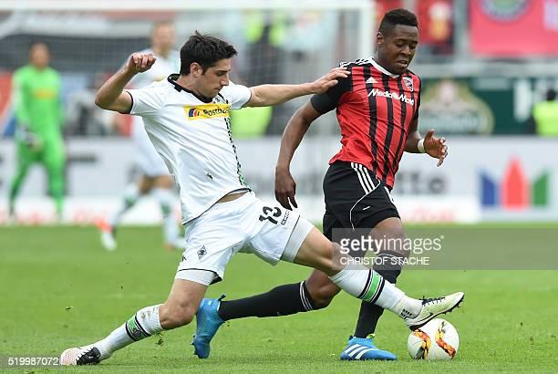 Ingolstadt's Brazilian midfielder Roger de Oliveira Bernardo and Moenchengladbach's midfielder Lars Stindl vie for the ball during the German first...