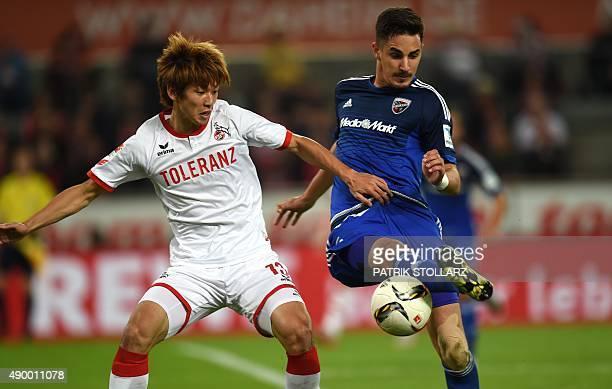 Ingolstadt's defender Benjamin Hübner and Cologne's Japanese striker Yuya Osaka vie for the ball during the German first division Bundesliga football...