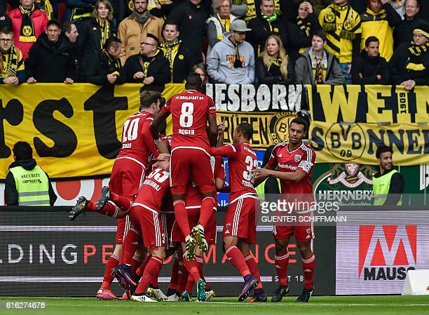 Ingolstadt's Israeli midfielder Almog Cohen celebrates after scoring the opening goal with his teammates during the German first division Bundesliga...