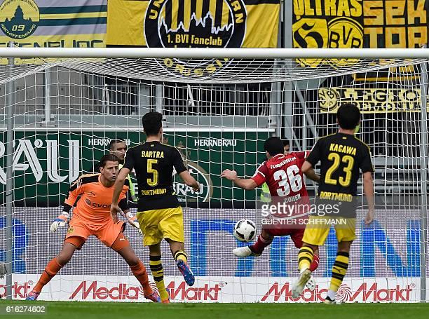 Ingolstadt's Israeli midfielder Almog Cohen scores the opening goal during the German first division Bundesliga football match between FC Ingolstadt...