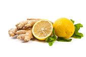Ginger, lemon, mint leaves on white background. Selective focus.