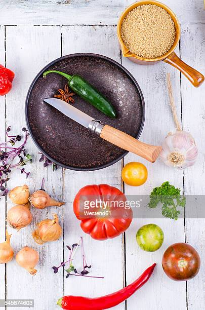 Ingredients, bowl and knife for preparing couscous