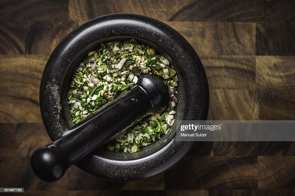 Ingredients for making green curry paste in mortar