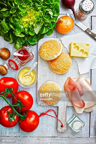 Ingredients of burgers on light ground, elevated view