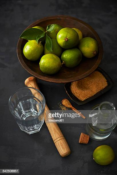 Ingredients of Caipirinha on dark ground