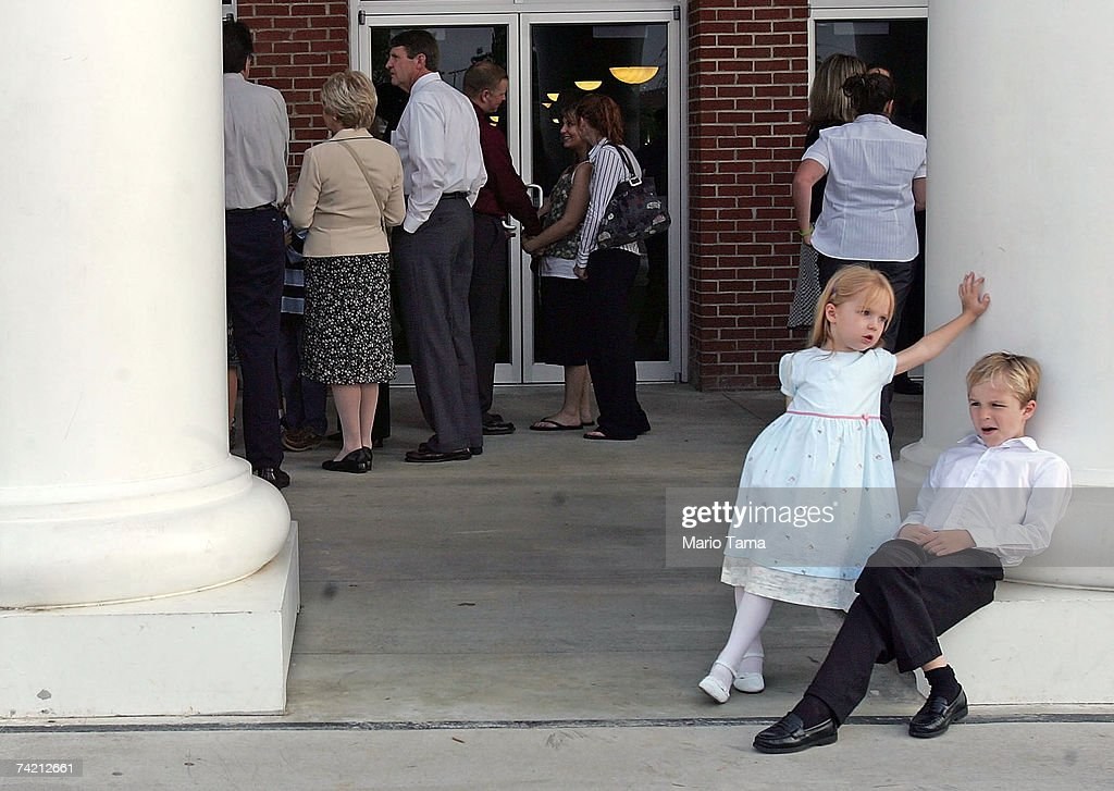 Ingrid, 5, and Kaleb Linderaldsen, 7, rest on columns as their parents and other mourners wait in line to view the body of Rev. Jerry Falwell lying in repose at Thomas Road Baptist Church May 21, 2007 in Lynchburg, Virginia. Funeral services for Falwell, founder of Liberty University and Thomas Road Baptist Church, will be held May 22 at Thomas Road Baptist Church.