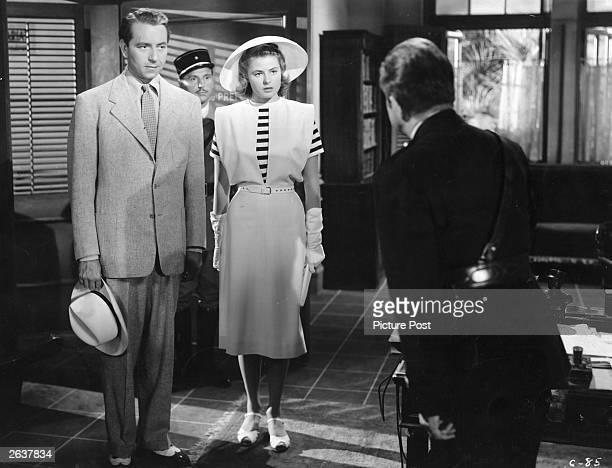 Ingrid Bergman and Paul Henreid meet Claude Rains in a scene from the film 'Casablanca' directed by Michael Curtiz for Warner Brothers Original...