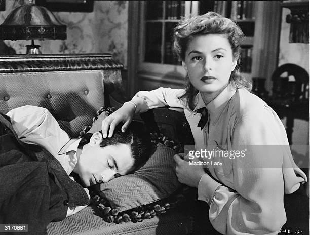 Ingrid Bergman nurses Gregory Peck in a scene from Alfred Hitchcock's psychological thriller 'Spellbound'