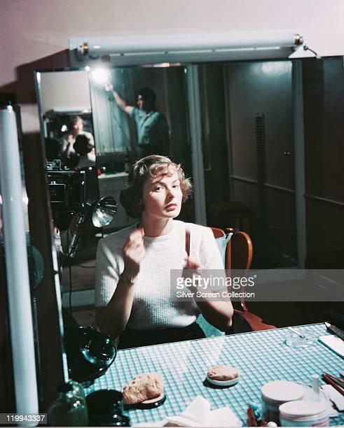 Ingrid Bergman Swedish actress applyig makeup while sitting on a film set circa 1940