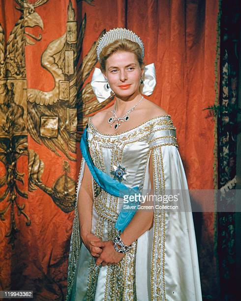 Ingrid Bergman Swedish actress wearing a regal silk dress with a silver necklace and tiara in a publicity portrait issued for the film 'Anastasia'...