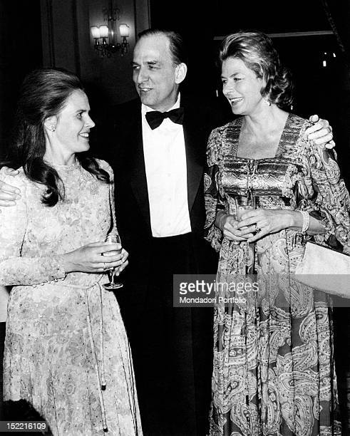 Ingrid Bergman together with the actress Liv Ullmann and Ingmar Bergman who is embracing both of them Cannes May 1973