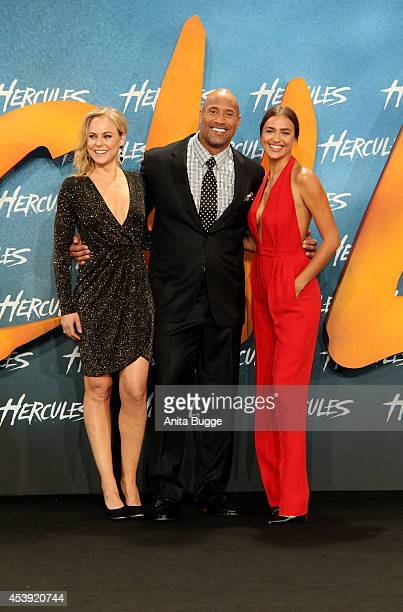 Ingrid Bolso Berdal Dwayne Johnson and Irina Shayk attend the Europe premiere of the film 'Hercules' at CineStar on August 21 2014 in Berlin Germany