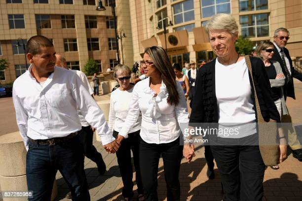 Ingrid Encalada Latorre and her partner Eliseo Jurado surrounded by Metro Denver Sanctuary Coalition members leaving the Jefferson County Courthouse...