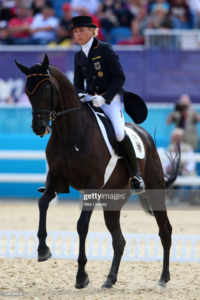 <a gi-track='captionPersonalityLinkClicked' href=/galleries/search?phrase=Ingrid+Klimke&family=editorial&specificpeople=647077 ng-click='$event.stopPropagation()'>Ingrid Klimke</a> of Germany riding Butts Abraxxas competes in the Dressage Equestrian event on Day 1 of the London 2012 Olympic Games at Greenwich Park on July 28, 2012 in London, England.