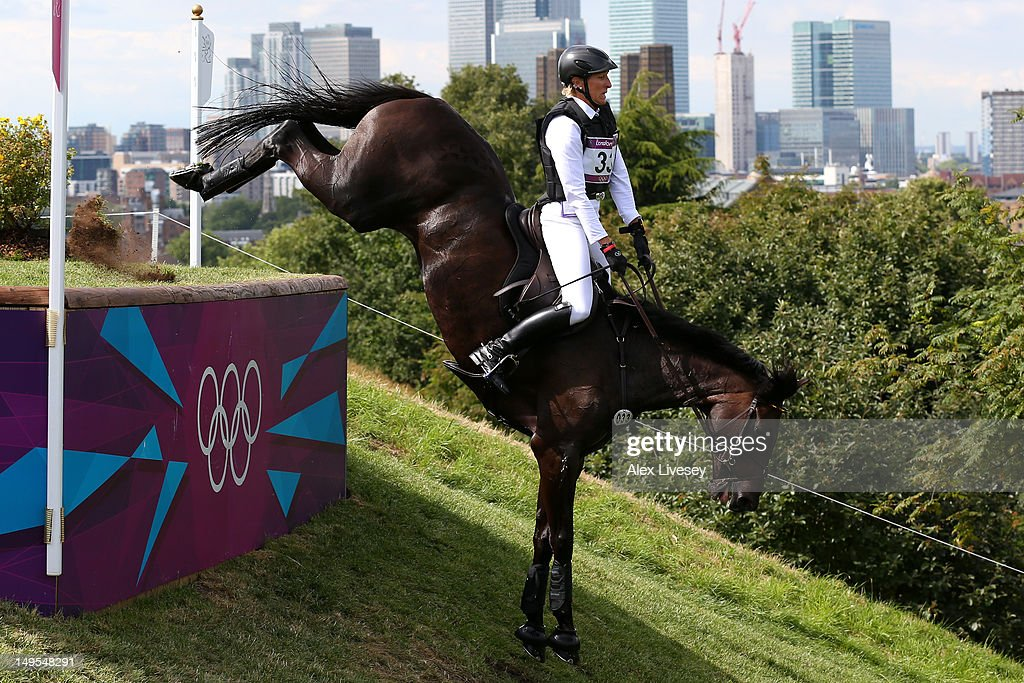 Ingrid Klimke of Germany riding Butts Abraxxas negotiates a jump in the Eventing Cross Country Equestrian event on Day 3 of the London 2012 Olympic Games at Greenwich Park on July 30, 2012 in London, England.