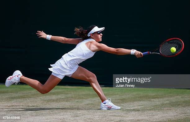 Ingrid Neel of the United States plays a backhand during the Girls Singles First Round match against Lauryn JohnBaptiste of Great Britain during day...