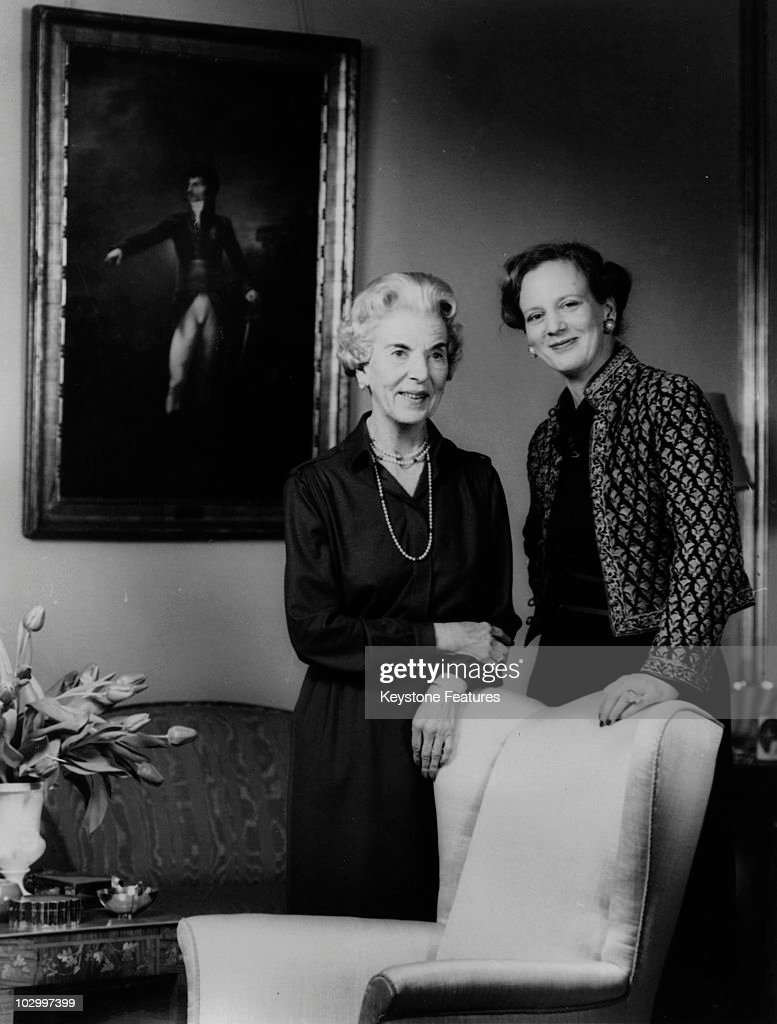 Ingrid of Denmark queen consort of King Frederick IX of Denmark with her daughter Queen Margrethe II of Denmark standing before a large portait in an...