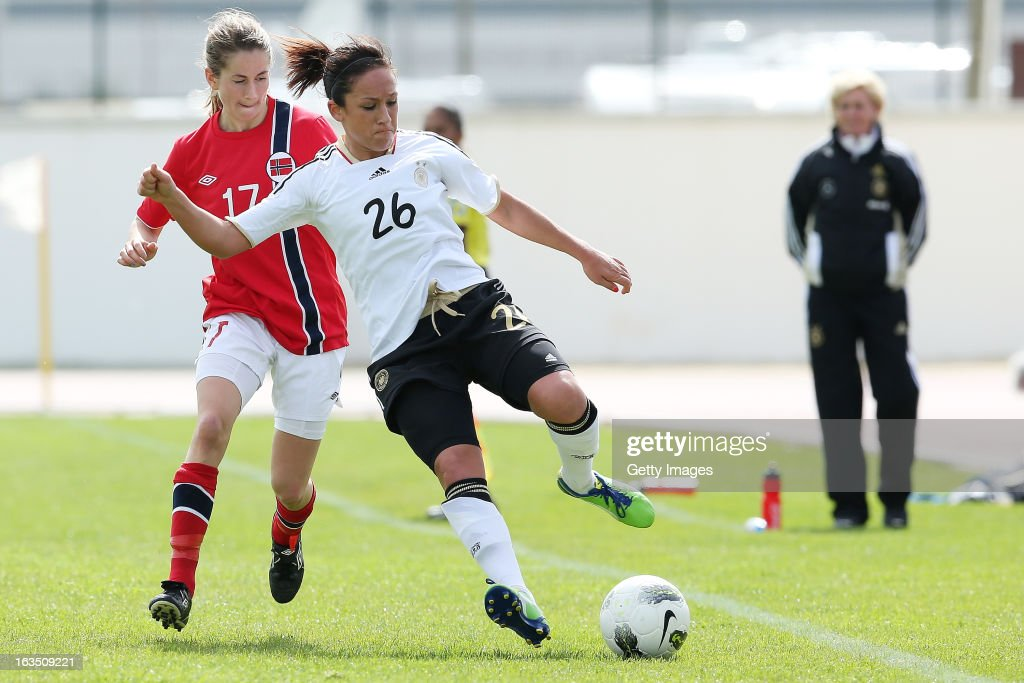 Ingrid Ryland #17 of Norway challenges Nadine Kebler #26 of Germany during the Algarve Cup 2013 match between Norway and Germany at the Estadio Municipal de Lagos on March 11, 2013 in Lagos, Portugal.