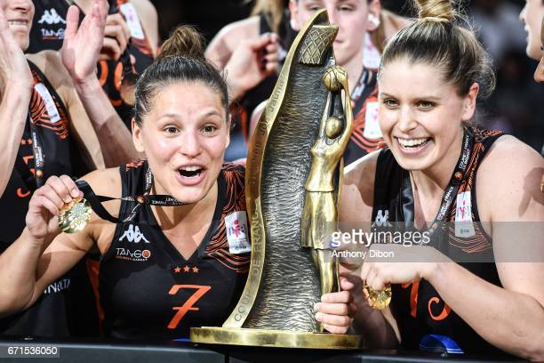 Ingrid Tanqueray and Johannah Alison Leedham of Bourges celebrates the victory with the trophy during the women's Final of the French Cup between...