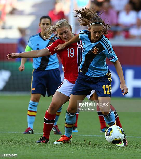 Ingvild Isaksen of Norway and Alexia Putellas of Spain battle for the ball during the UEFA Women's Euro 2013 quarter final match between Norway and...