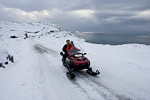 Inhabitants arrive in the town of Ilulissat on their snowmobile Though the disappearing ice cap could lead to higher sea levels all over the world...